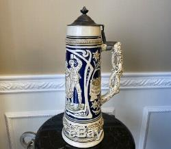 Antique 2L German 15 Beer Stein With Cobalt Blue and White Raised Bar Scene