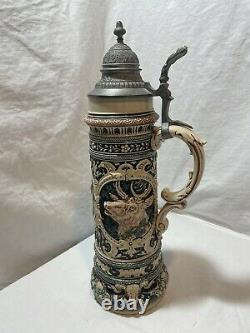 Antique german beer stein 15 tall. Excellent condition. Beautiful Handle & Lid